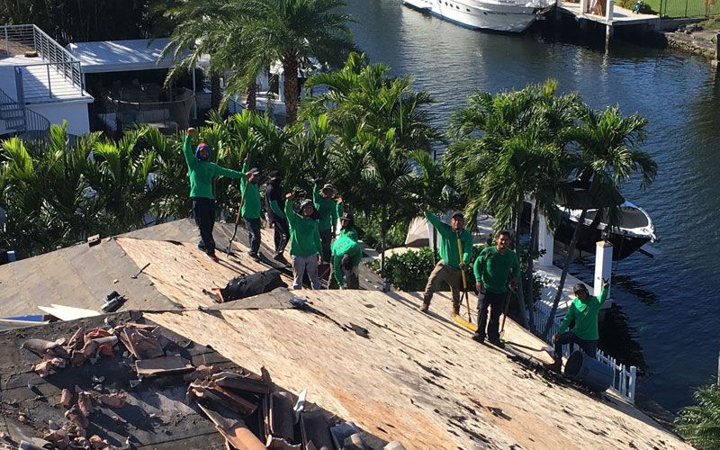 Fabienne-Feras-Ladin-with-Evans-Roofing-in-Oakland-Park-FL-Waving-Roofers